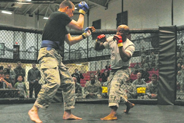 Sgt. 1st Class Calvin Cunningham, right,169th Engineer Battalion, squares off against Pfc. Justin Scarborough, 50th Multi-Role Bridge Company, 5th Engineer Battalion.