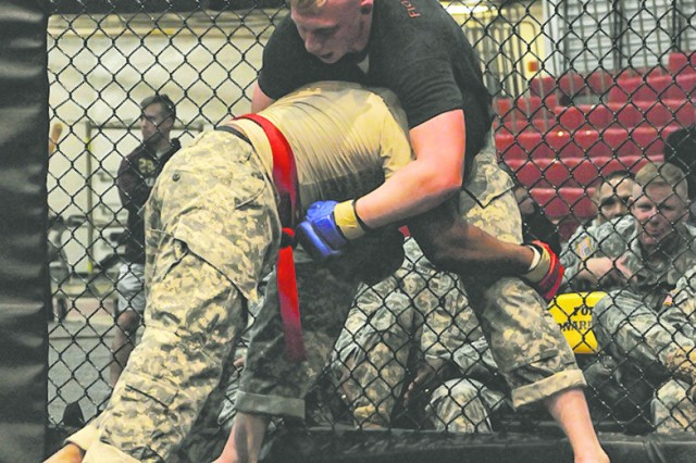 Staff Sgt. Bruno Richardson HHC, 3rd Chemical Brigade attempts a takedown of Sgt. Wyatt Schwemin, 5th Engineer Battalion.