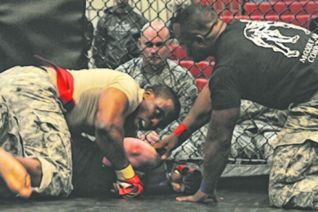 Staff Sgt. Bruno Richardson HHC, 3rd Chemical Brigade forces a tap out of Sgt. Wyatt Schwemin, 5th Engineer Battalion.