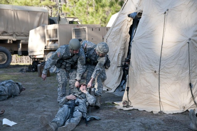 U.S. Army Reserve Soldiers with the 391st Engineer Battalion pull a simulated casualty to safety during an impromptu mass casualty exercise March 7 at Fort Jackson, S.C. during their field training exercise. (U.S. Army photo by Staff Sgt. Debralee Best)