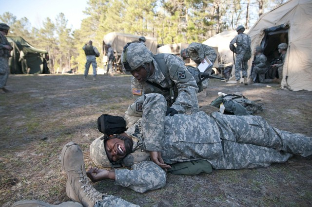 A U.S. Army Reserve medic with the 391st Engineer Battalion treats a simulated casualty during an impromptu mass casualty exercise March 7 at Fort Jackson, S.C., during their field training exercise. (U.S. Army photo by Staff Sgt. Debralee Best)
