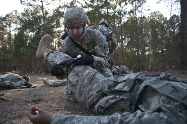 A U.S. Army Reserve medic with the 391st Engineer Battalion treats a simulated casualty during an impromptu mass casualty exercise March 7 at Fort Jackson, S.C. during their field training exercise. (U.S. Army photo by Staff Sgt. Debralee Best)