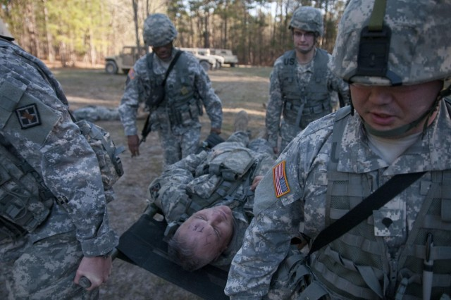 U.S. Army Reserve Soldiers with the 391st Engineer Battalion transport a simulated casualty during an impromptu mass casualty exercise March 7 at Fort Jackson, S.C., during their field training exercise. (U.S. Army photo by Staff Sgt. Debralee Best)