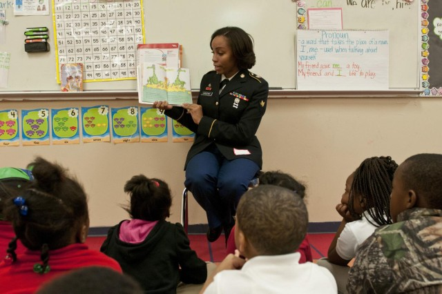 U.S. Army Reserve Spc. Danielle Greene, human resources specialist, Headquarters and Headquarters Company, 412th Theater Engineer Command, reads a story to a kindergarten class at Sherman Avenue Elementary School in Vicksburg, Miss. Approximately 15 U.S. Army Reserve Soldiers and civilians with the 412th TEC read Dr. Seuss stories to kindergarten through second grade classes at the school as part of Read Across America March 2 to 6. (U.S. Army photo by Staff Sgt. Debralee Best)