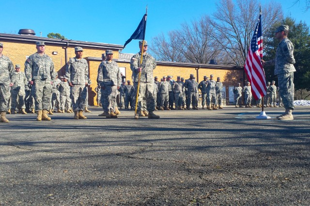 Army Reserve Soldiers stand ready to the take the oath of reenlistment administered by Brig. Gen. Richard Torres, 80th TC, deputy commander, prior to a mass ceremony in Richmond Va., March 7, 2015. The reenlistment ceremony was part of Operation Full Court Press; a congressionally-mandated initiative designed to help the Army Reserve retain Soldiers. Participating Soldiers represented the 80th Training Command (TASS), the 275th Quartermaster Company, the 55th Sustainment Brigade, and the 380th Army Band 99th Regional Support Command,