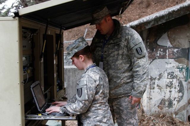 5th CORPS, IDONG, Korea -- Pfc. Jessica A. Hagerty, Multichannel Transmission Systems Operator and Maintainer, 304th ESB, 1st Signal Brigade, operates satellite equipment at 5th Corps, Idong, South Korea on Mar. 11 during the Key Resolve 15 combined training exercise.