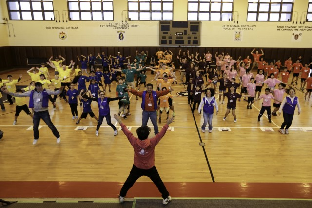 The gymnasium at Torii Station echoed with both Japanese and English cheers and applause March 14 as dozens of local residents from Yomitan Village assembled with their Army neighbors to participate in the seventh annual U.S. -- Japan Sports Exchange Day.