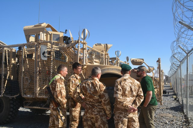 Soldiers from the Romanian National Service Element and the 33rd Mountain Battalion (Romania) force protection unit, get some pointers on the Symphony from a field service representative, Mar. 2 at Kandahar Airfield.
