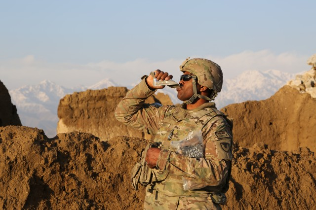 A Soldier digs into a First Strike Ration in the mountains of Afghanistan. Nutritional information about the First Strike Ration and other individual rations is now available at the online combat rations database.
