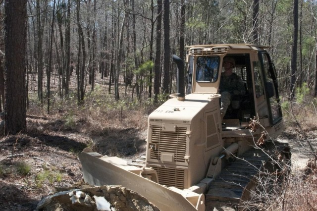 U.S. Army Reserve Soldiers with the 357th and 712th Engineer Support Companies conduct road improvements March 7 at Fort Jackson, S.C. during their field training exercise. The companies are subordinate units to the 391st Engineer Battalion who has partnered with Fort Jackson for a variety of construction projects to improve the fort. (U.S. Army photo by Staff Sgt. Debralee Best)
