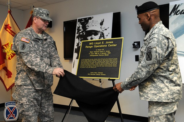 Col. Gary A. Rosenberg, left, Fort Drum garrison commander, and Brig. Gen. Carl A. Alex, 10th Mountain Division (LI) deputy commanding general of support, unveil a plaque that will be affixed to the Maj. Gen. Lloyd E. Jones Range Operations Center.