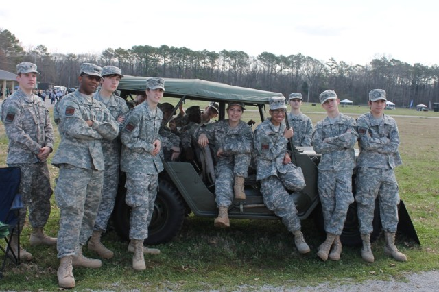 James Clemens cadets take a break for a photo in a jeep on display by the U.S. Veterans Memorial Museum.