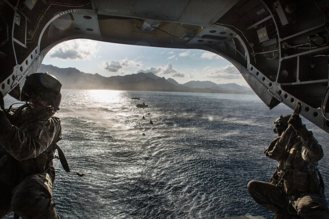CH-47F Chinook helicopter crew chiefs, assigned to 25th Combat Aviation Brigade, 25th Infantry Division, support 1st Special Forces Group during helocast operations into the waters off of Marine Corps Training Area Bellows, Hawaii, March 16, 2015.