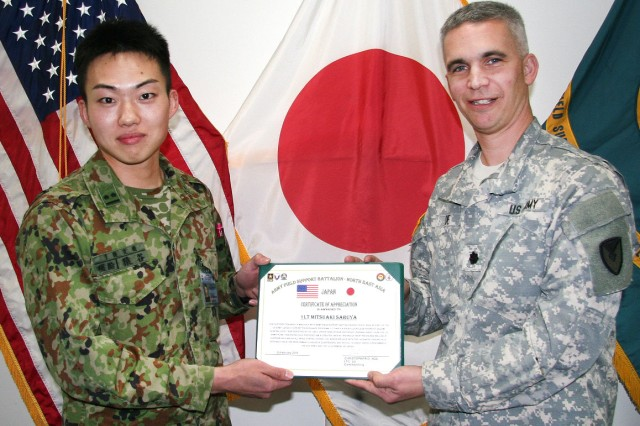 Lt. Col. Christopher Noe, commander, Army Field Support Battalion-Northeast Asia, presents 1st Lt. Matsuaki Saruya, 1st Logistics Support Regiment, Japanese Ground Self Defense Force, a certificate of appreciation from for his time with the battalion as part of the U.S. Army Japan Cooperative Exchange Program Class #75. (Photo by Arika Morita, AFSBn-NEA)