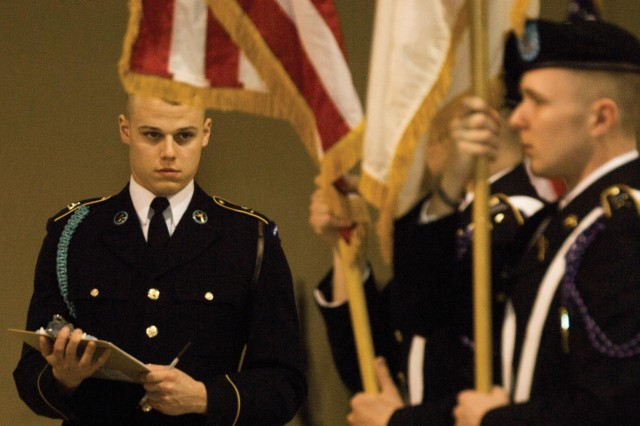 Pfc. Benjamin Olson, from Headquarters and Headquarters Company, 4th Battalion, 3rd United States Infantry Regiment (The Old Guard), Fort Myer, evaluates the moves of a four-person color guard team during the John J. Pershing Memorial Drill Competition on March 14 at the Greater Richmond Convention Center. Olson is a member of the U.S. Army Color Guard.