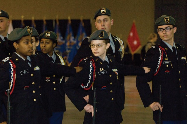 Katherine Loden, center, an Army family member from Fort Lee, competes with her JROTC classmates from Dinwiddie High School during the 2015 John J. Pershing Memorial Drill Competition on March 14 at the Greater Richmond Convention Center. Her team placed first in the Blackjack platoon and squad regulation armed drill categories, and second in the inspection and color guard categories at the event.