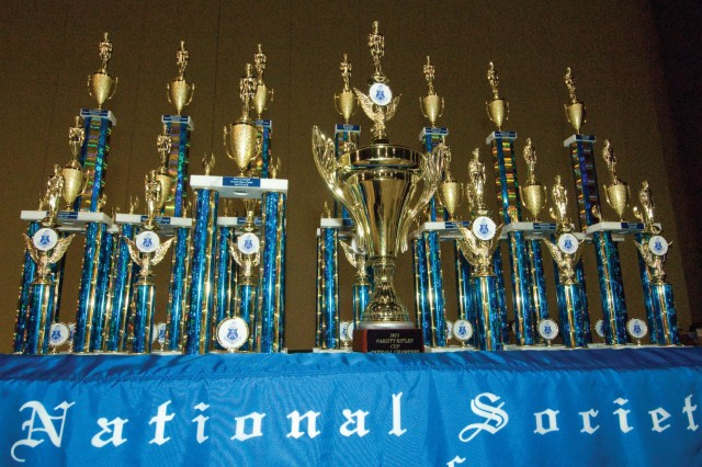 A display at the 2015 John J. Pershing Memorial Drill Competition, held March 14 at the Greater Richmond Convention Center, includes the Varsity Rifles championship trophy, center. It was later presented to Pershing Rifles Company L-1, University of Toledo, the overall winners of the event. This is the second year the ROTC team has taken home the top prize.