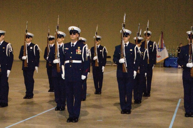 The U.S. Coast Guard Silent Drill Team demonstrates its military poise and precision during a lunchtime performance at the 2015 John J. Pershing Memorial Drill Competition on March 14 in the Greater Richmond Convention Center.