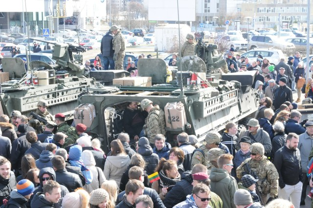 U.S. Soldiers, from Lightning Troop, 3rd Squadron, 2nd Cavalry Regiment, convoy through Lithuania as part of Operation Dragoon Ride in Vilnius, Lithuania, March 22, 2015.