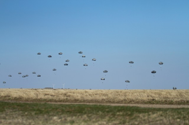 U.S. Army paratroopers, assigned to the 173rd Airborne Brigade, conduct an airborne operation during combined early-entry Exercise Saber Junction at Smardan Training Area, Romania, March 24, 2015. Saber Junction 15 includes 5,000 troops from 17 NATO allied and partner nations.