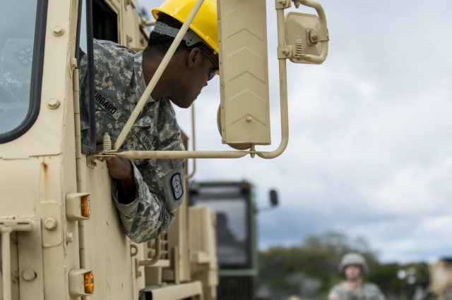 An Army Reserve Soldier, with the 277th Engineer Company (Horizontal), backs up a heavy expanded mobility tactical truck during vehicle staging at Camp Bullis, Texas, March 22, 2015.