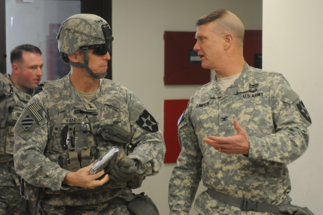 CAMP MOBILE, South Korea -- Maj. Gen. Thomas Vandal, the commander of 2nd Infantry Division, talks to Col. Michael Lawson, the commander of 210th Field Artillery Brigade, 2nd Inf. Div., during Key Resolve, March 2, 2015 at the brigade's tactical operation center at Camp Mobile, South Korea. The exercise aims to strengthen the alliance between the Republic of Korea and U.S. in defending South Korea from any Northern aggression.