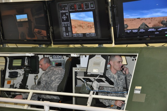 Sgt. 1st Class Jeremy Rae and Sgt. 1st Class Gedney Riley operate the new Stryker simulator at the Chemical Corps Wing in Thurman Hall. The simulator adds a safety measure for Soldiers to get realistic, hands-on training before they actually get into the vehicle.