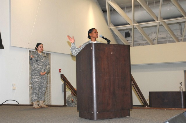 U.S. Army Transportation Regimental Command Sgt. Maj. Cynthia Howard speaks about strong female influences in her life during the 2015 Women's History Month event at Fort Leonard Wood.