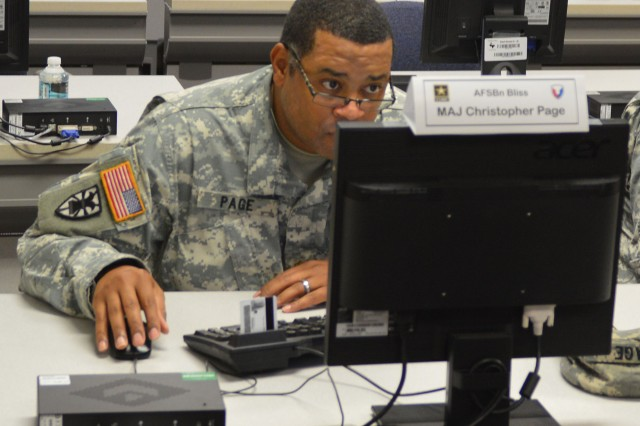 Maj. Christopher Page, 1st Stryker Brigade, 1st Armored Division Brigade Logistics Support Team chief, Army Field Support Battalion-Bliss, concentrates during BLST University training at Fort Hood, Texas,  March 13. (Photo by Jeffery Kent, AFSB Public Affairs)