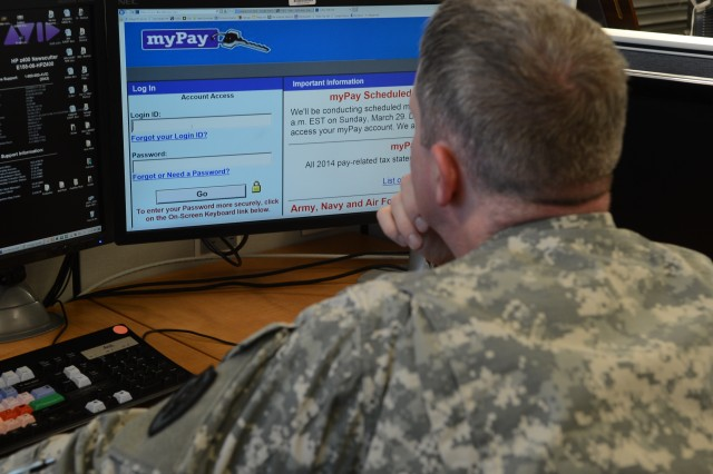 """A Soldier logs in to check his leave accrual on the """"My Pay"""" site, provided by the Defense Finance and Accounting Service."""