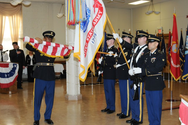 The Army Sustainment Command honor guard rolls up the United States Flag to retire the colors at the conclusion of the Rock Island Arsenal Retirement and Retreat Ceremony, March 26.