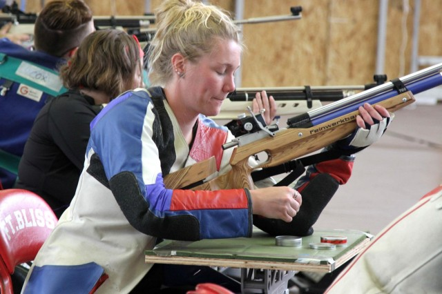 Spc. Chasity Kuczer, locomotive mechanic, Warrior Transition Battalion, Fort Knox, Ky., loads her air rifle during the zeroing phase at Milam Gym, Fort Bliss, Texas, March 30, 2015. Kuczer is scheduled to participate in every event at Army Trials except cycling and running.