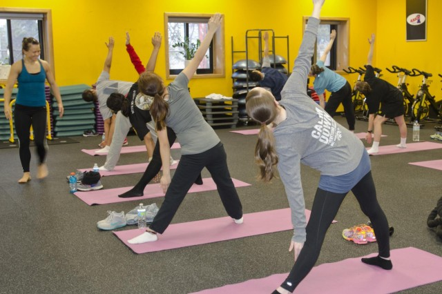 Soldiers of 2nd Infantry Division practice yoga during Pregnancy and Postpartum Physical Training Program at Camp Casey, South Korea March 20. The females focused on stretching and balance, preparing them for delivery. (U.S. Army photo by Spc. Lauren Wanda, 1st ABCT Public Affairs)
