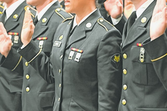 Spc. Jamie Boyd takes her oath during the graduation ceremony.