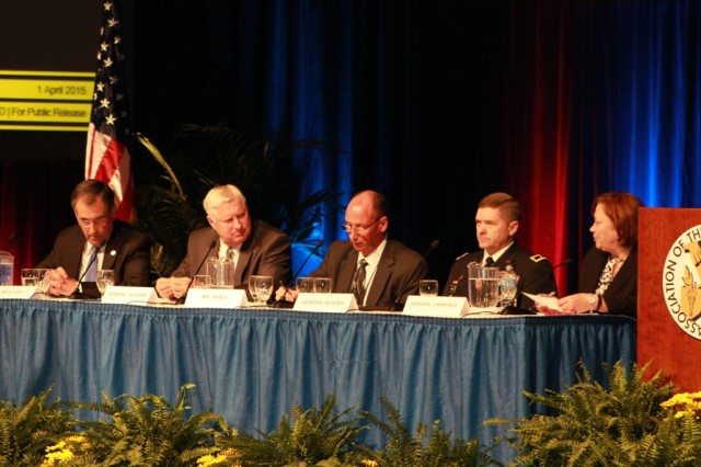 "Left to right, James Woolsey, retired Maj. Gen. Galen Jackman, Kevin Fahey, Maj. Gen. Daniel Hughes and retired Lt. Gen. Susan Lawrence discuss ""Systems Engineering and Acquisition for the Cyber Challenge"" at the AUSA 2015 Global Force Symposium & Exposition in Huntsville, Ala. April 1. Photo by Amy Guckeen Tolson."
