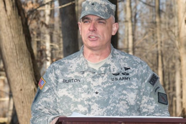 Brig. Gen. JB Burton, commanding general of the 20th Chemical, Biological, Radiological, Nuclear and Explosive, or CBRNE, Command, congratulates the graduates of the inaugural CBRNE Leaders Course at Gunpowder Range, Md., April 2, 2015.