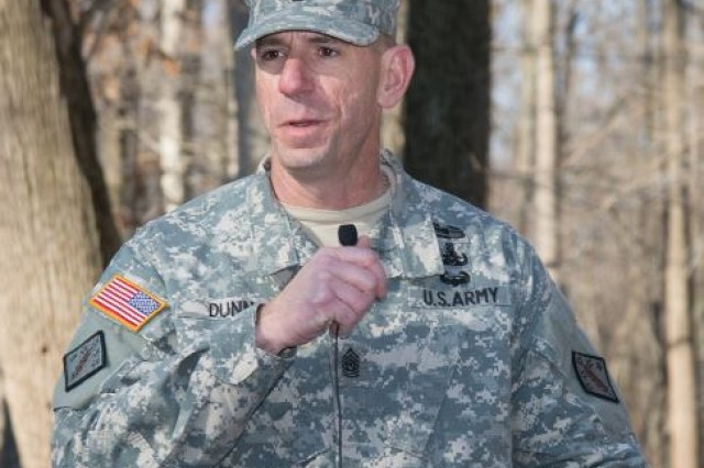 Command Sgt. Maj. Harold E. Dunn IV, senior enlisted leader of the 20th Chemical, Biological, Radiological, Nuclear and Explosive, or CBRNE, Command, congratulates the graduates of the inaugural CBRNE Leaders Course at Gunpowder Range, Md., April 2, 2015.