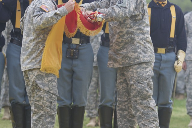 Col. Patrick Gaydon, commander of Division Artillery, 1st Cavalry Division, (right) and Command Sgt. Maj. Berk Parsons, senior enlisted advisor of DIVARTY, 1st Cav. Div., (left) case the colors of the 41st Field Artillery Brigade during the activation ceremony of the 1st Cav. Div. Artillery at Cooper Field, here, April 2. (U.S. Army photo by Sgt. Garett Hernandez, 1st Cavalry Division Artillery Public Affairs)