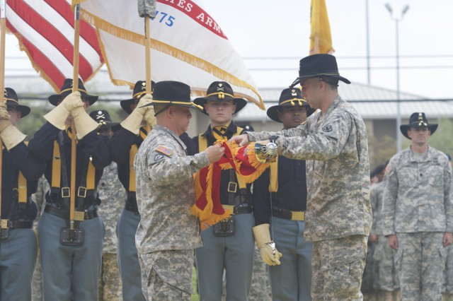 Col. Patrick Gaydon, commander of Division Artillery, 1st Cavalry Division, (right) and Command Sgt. Maj. Berk Parsons, senior enlisted advisor of DIVARTY, 1st Cav. Div., (left) uncase the colors of the 1st Cavalry Division Artillery during an activation ceremony at Cooper Field, here, April 2. (U.S. Army photo by Sgt. Garett Hernandez, 1st Cavalry Division Artillery Public Affairs)