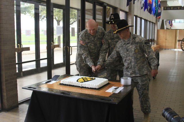 Gen. Ray Odierno, Chief of Staff of the U.S. Army and former commander of the Division Artillery, 1st Cavalry Division, (left) along with Col. Patrick Gaydon, commander of DIVARTY, 1st Cav. Div., (center) and Command Sgt. Maj. Berk Parsons, senior enlisted advisor of DIVARTY, 1st Cav. Div., (right) cut a cake in celebration of the reactivation of the unit following a ceremony here, April 2. (U.S. Army photo by Sgt. Garett Hernandez, 1st Cavalry Division Artillery Public Affairs)