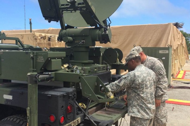 ANDERSON AFB, Guam- SGT Jarius Bruce and SPC Christopher Quiocho from the 307th Signal Battalion conduct maintenance on the Command Post Node. The 307th Sig. Bn. Soldiers provide communications support for the Task Force Talon Terminal High Altitude Area Defense (THAAD) mission on Guam.