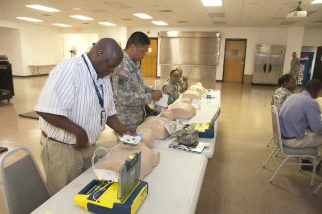 Staff Sgt. Cedric Douglas (left), culinary specialist and logistic management specialist, 412th Theater Engineer Command, participates in automated external defibrillator/cardiopulmonary resuscitation training June 24 at the George A. Morris Army Reserve Center in Vicksburg, Miss. (U.S. Army photo by Staff Sgt. Debralee Best)
