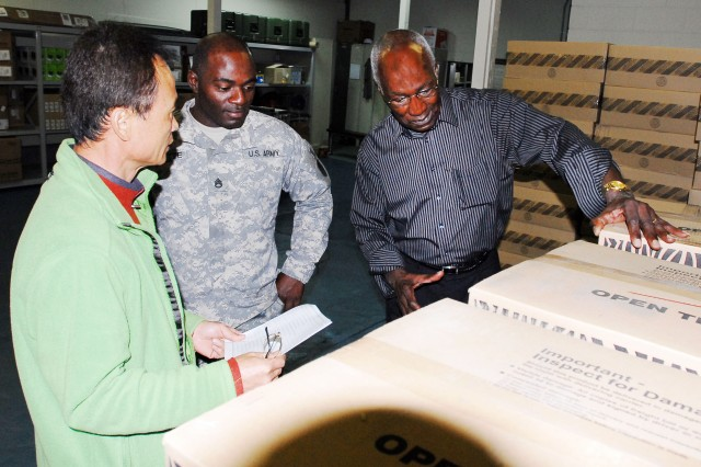 John L. Weal, chief of the Asset Management Branch, Logistics Readiness Center -- Daegu (right), conducts an inventory with Chan Mo-Pak and Staff Sgt. Sherman Levette at the LRC-Daegu Redistribution Center (Photo by Geno Sergi, LRC-Daegu)