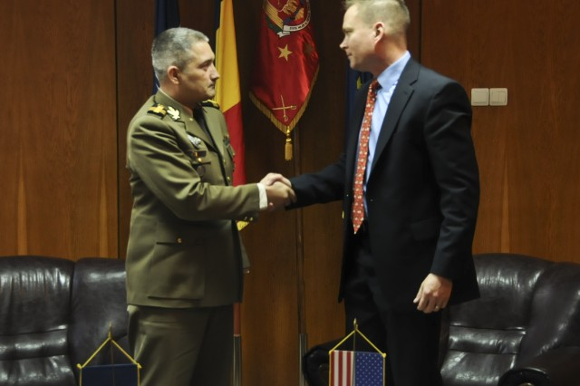 Col. Dragos Iacob (left,) Deputy Chief of Training and Doctrine Command, Land Forces Headquarters and Lt. Col. Theodore A. Johnson (right,) squadron commander assigned to 2nd Squadron, 2nd Cavalry Regiment, shake hands at the conclusion of their meeting at Land Forces Headquarters in Bucharest, Romania, Apr. 2, 2015. The purpose of the meeting was to discuss how to coordinate efforts between the squadron and their Romanian counterparts during the unit's support of Operation Atlantic Resolve-South. (U.S. Army photo by Sgt. William A. Tanner/released)