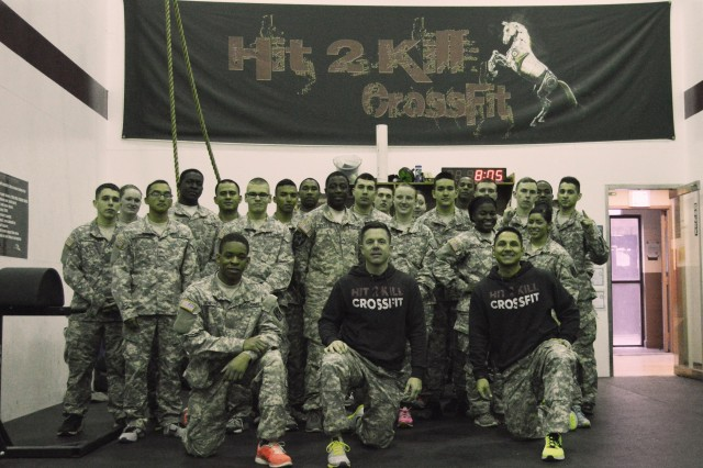 The newest Soldiers with 6-52 Air Defense Artillery pose for a group picture with the instructors of the Hit 2 Kill CrossFit box, Chief Warrant Officer 3 Bradford Hudgins, standardizations officer, and Chief Warrant Officer 3 Juan Perez, tactical director, on Suwon Air Base.  New Soldiers with 6-52 ADA train with the unit's veteran CrossFit instructors to prepare them for their tour with the Iron Horse Battalion. (Photo by Sgt. Shin, YoungJae, 6-52 ADA Public Affairs)