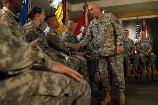 Army Chief of Staff Gen. Ray Odierno greets 22 Soldiers before a virtual town hall on Fort Hood, Texas, April 2, 2015.