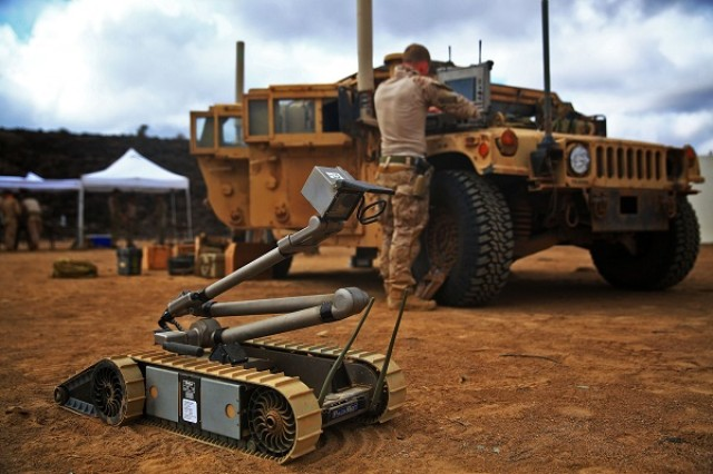 A PackBot is shown ready for use in Djibouti.