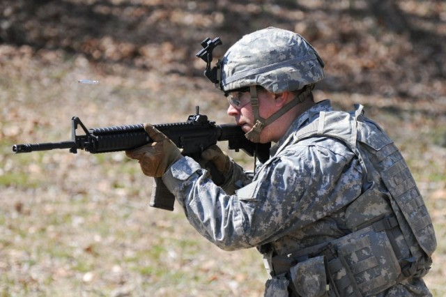 A Soldier from 20th CBRNE Command takes on mock enemy forces during the inaugural CBRNE Leaders Course at Gunpowder Range, Maryland, March 31.
