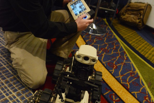 Mark Kergan, of Robotcam North America, is shown beside his Micro-Tactical Ground Robot.
