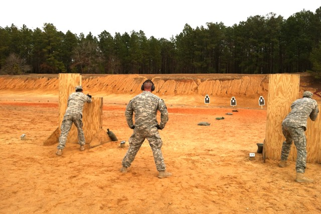 2nd Lt. Aaron Catlin, left, and Staff Sgt. Victor Halatchenko, right, practice their shooting, assisted by Fort Drum Light Fighters School marksmanship instructor Sgt. 1st Class John Brady. Brady travelled with the Soldiers to help prepare them for some of the elements they must complete during the competition.